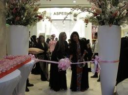 Eman and Elham Al Flamrzi visit Taste of Wafi - cutting ribbon